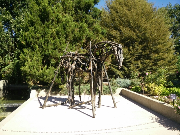 The gardens were hosting an art exhibit of horses made out drift wood.